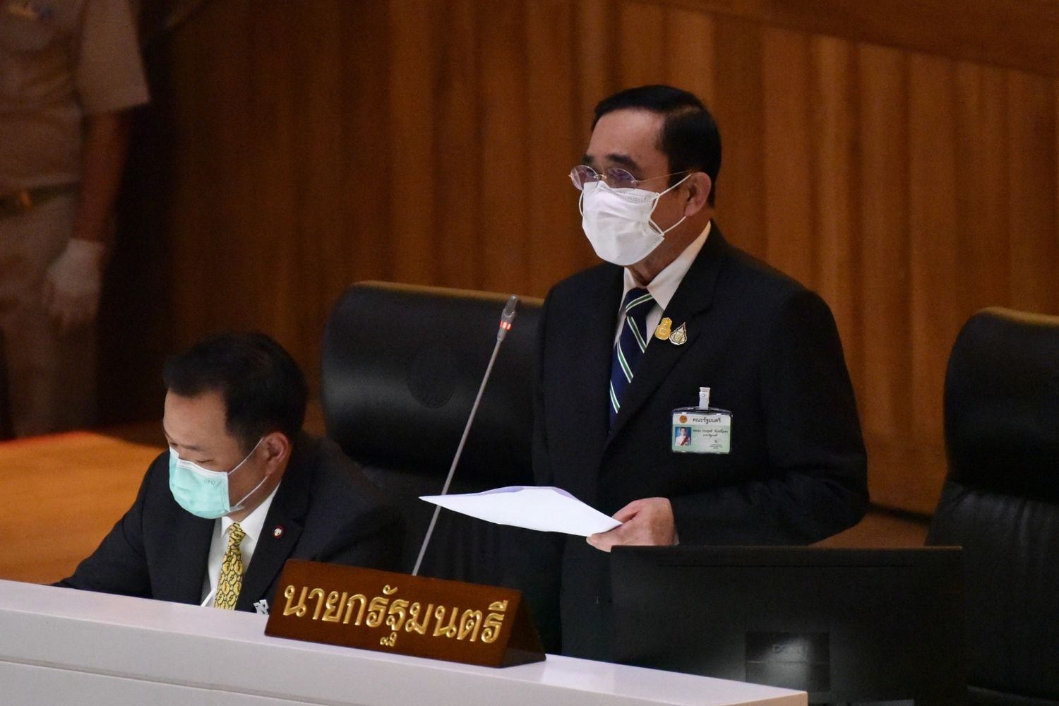 Prime Minister Prayut Chan-o-cha speaks at Parliament during the no-confidence debate on Thursday. (Parliament of Thailand photo)