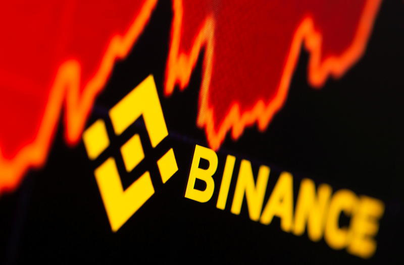 Binance logo and stock graph are displayed in this illustration taken on June 28, 2021. (Reuters photo)