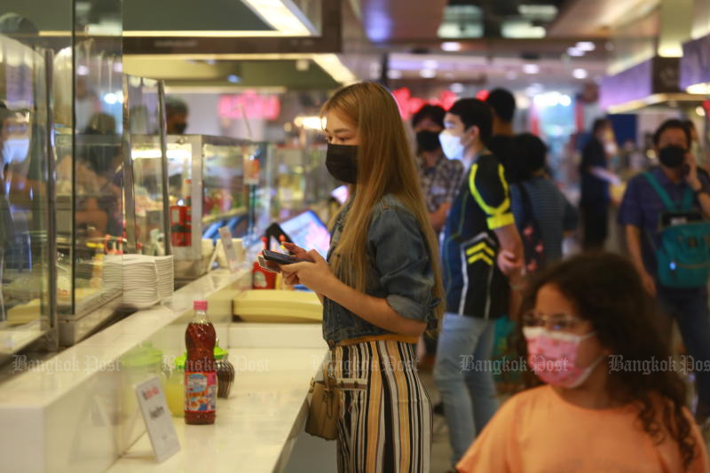 People flock to the food court of the Seacon Square shopping centre in Bangkok's Srinakarin area on Wednesday after dine-in is allowed. Government subsidies have contributed to a surprise drop in headline inflation. (Photo: Somchai Poomlard)