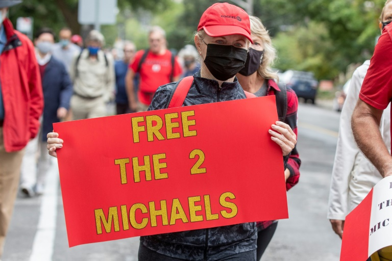 Supporters of Michael Kovrig and Michael Spavor take part in a 5-kilometre walk in Ottawa, Ontario on Sept 5, 2021, to mark the pair's 1,000 days in Chinese custody after they were charged with espionage.