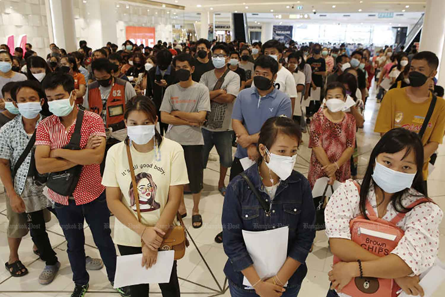 People wait for their turn to be vaccinated on Monday at Future Park shopping centre in Pathum Thani, a venue which is capable of inoculating up to 4,000 people a day. Pathum Thani is aiming to inoculate 1 million people. (Photo: Apichit Jinakul)