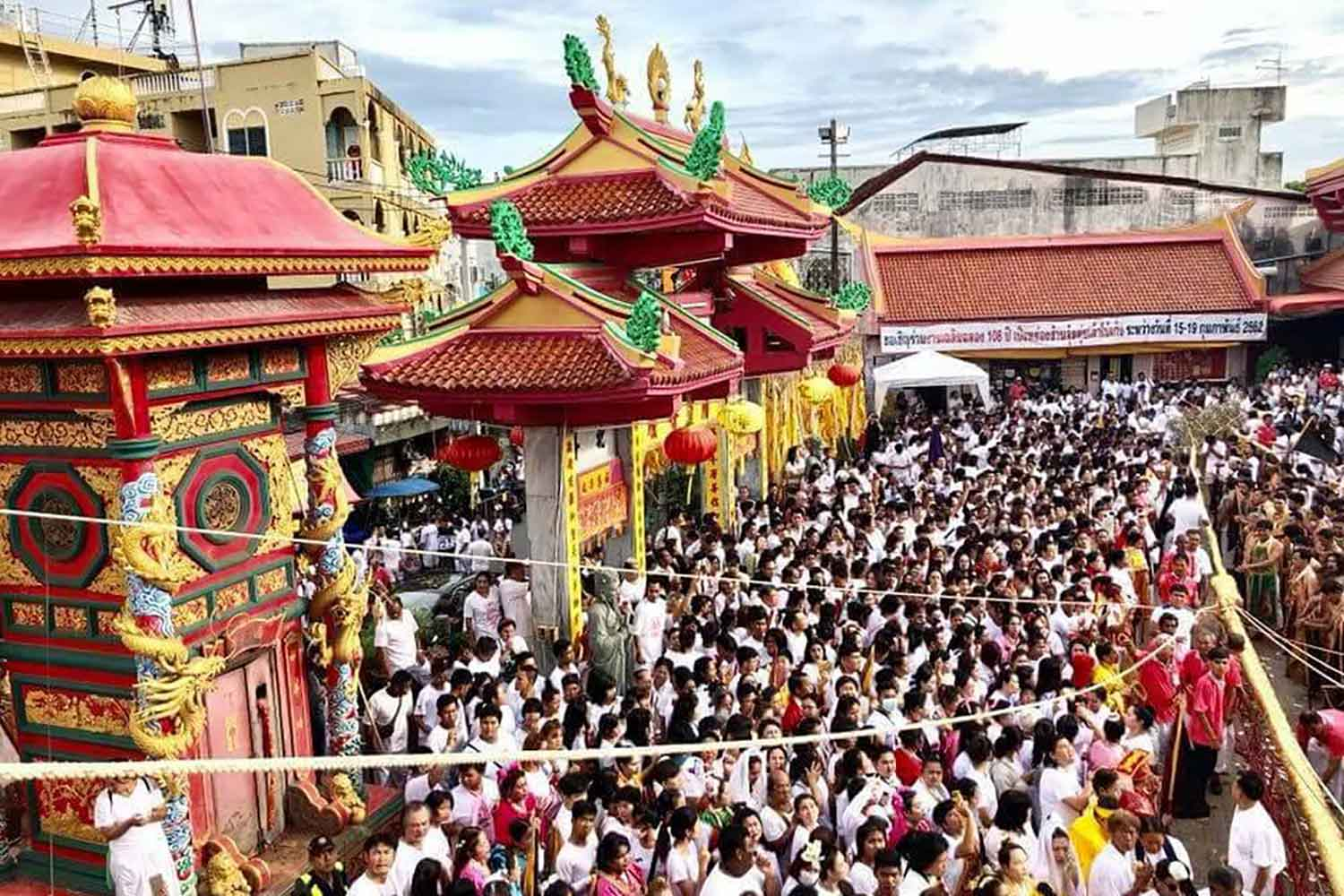 Pre-Covid: People crowd a shrine during the Phuket vegetarian festival. What form it will take this year is still being decided.  (File photo)