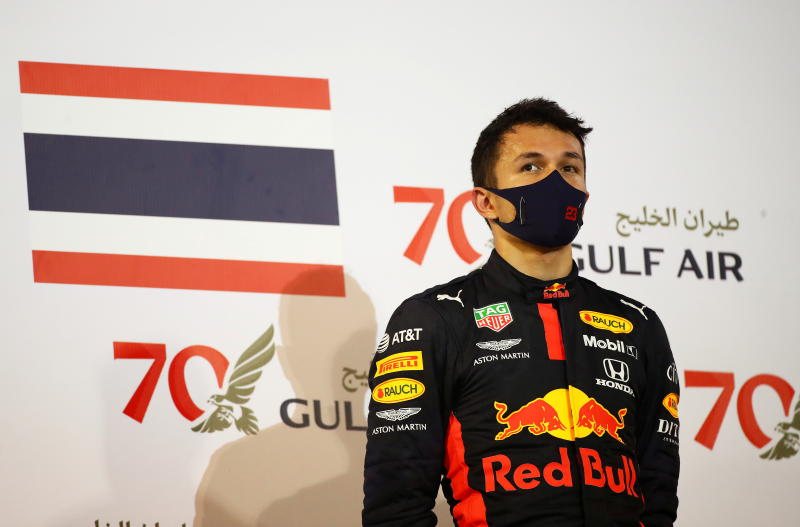 FILE PHOTO: Red Bull's Alexander Albon celebrates on the podium after finishing in third place in the Formula One Bahrain Grand Prix at Bahrain International Circuit, Sakhir, Bahrain, Nov 29, 2020. (Reuters)
