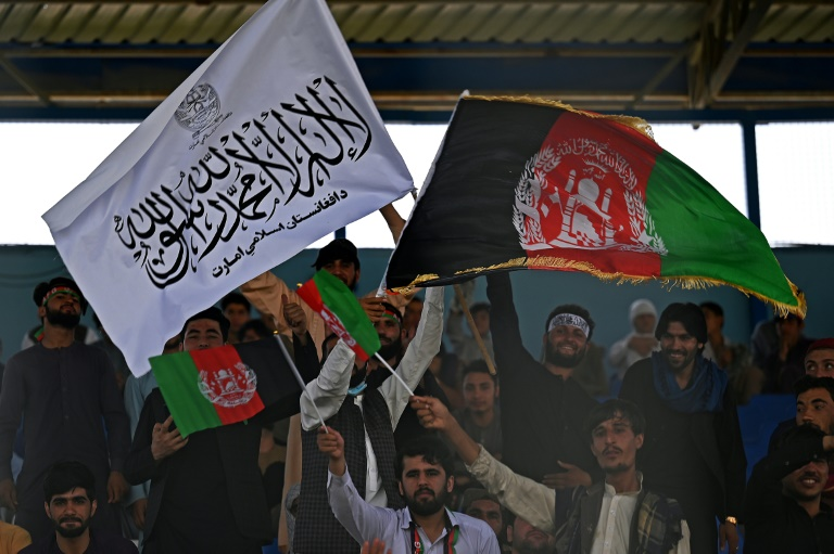 Spectators wave Afghanistan and Taliban flags at a Twenty20 cricket trial match in Kabul last week. Australia said Thursday they will call off a historic first ever Test against Afghanistan unless the Taliban allows women to play sport