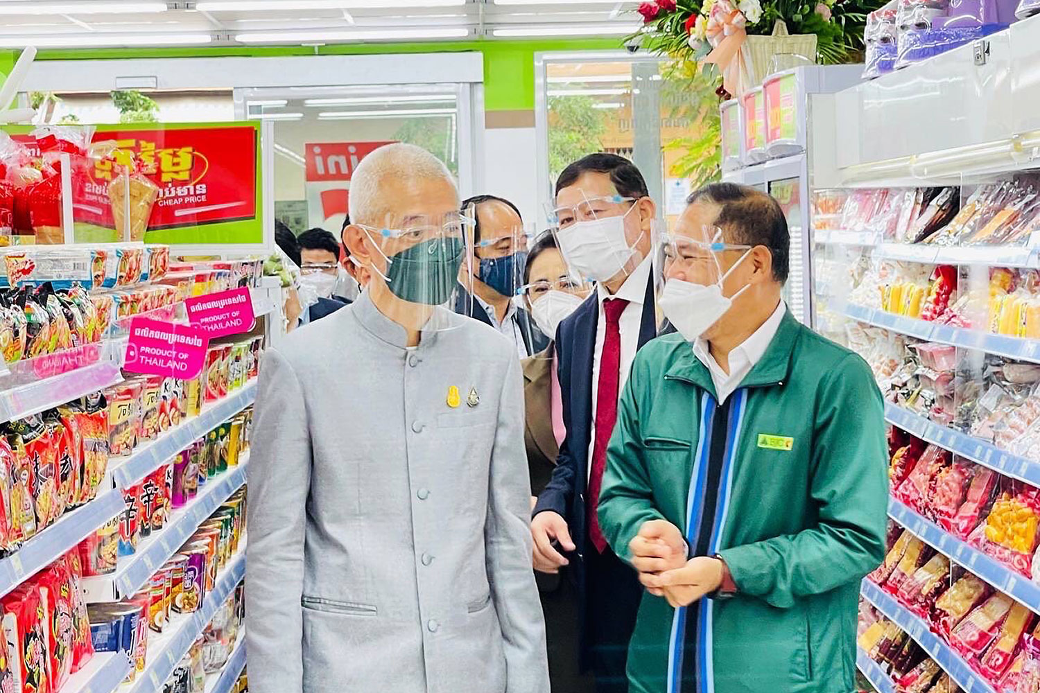 Pictured from left are Thai ambassador to Cambodia Panyarak Poolthup, Cambodian Undersecretary of State Penn Sovicheat and Suwin Somsri, vice-president of Big C Cambodia, at the opening of the first Mini Big C store in Phnom Penh on Sept 5.