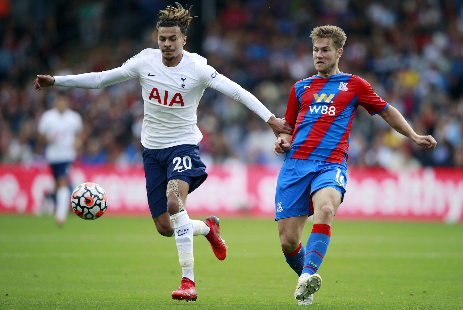 Eye on the ball: Dele Alli of Tottenham Hotspur is pursued by Joachim Andersen of Crystal Palace during their Premier league match at Selhurst Park in London on Saturday. (Reuters Photo)