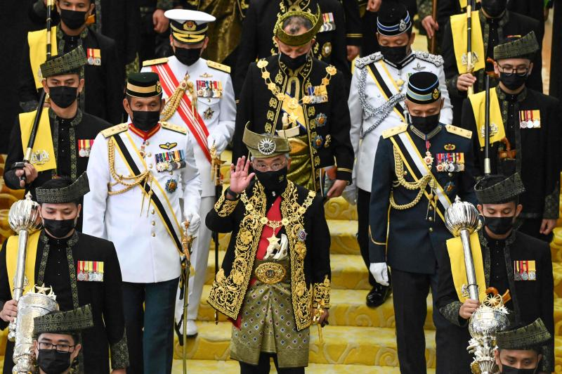 This handout photo from Malaysia's Department of Information taken and released on Sept 13, 2021 shows Malaysia's King Sultan Abdullah Sultan Ahmad Shah (centre) waving as he arrives for the opening ceremony of the 14th parliamentary sessions in Kuala Lumpur.