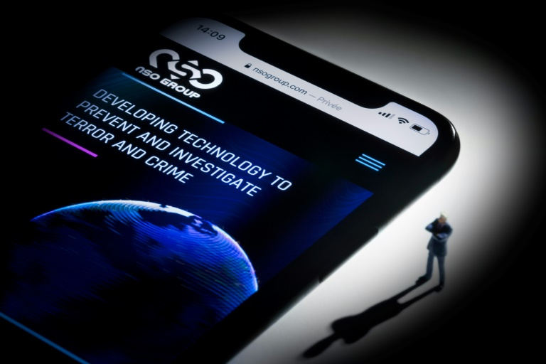 In this file photo taken on July 21, 2021, the studio photographic illustration shows a smartphone with the website of Israel's NSO Group which features 'Pegasus' spyware, on display in Paris. (AFP photo)