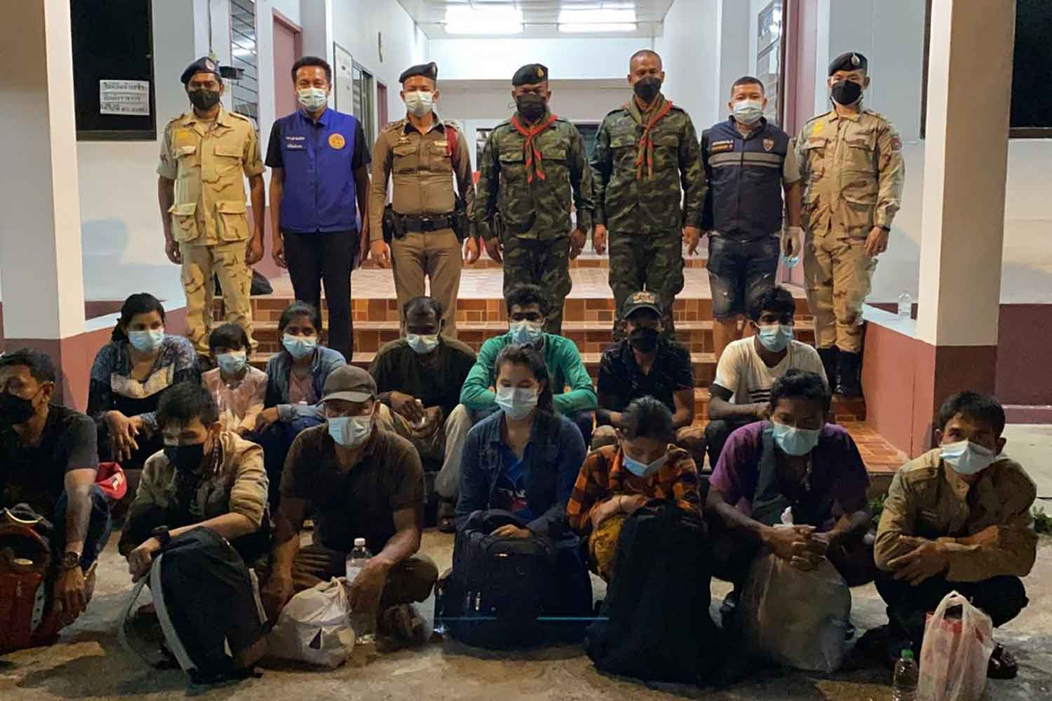 The 14 illegal Myanmar migrants at Sadao police station in Songkhla after they were caught on Sept 11 while waiting to be smuggled into Malaysia. (Photo: Assawin Pakkawan)