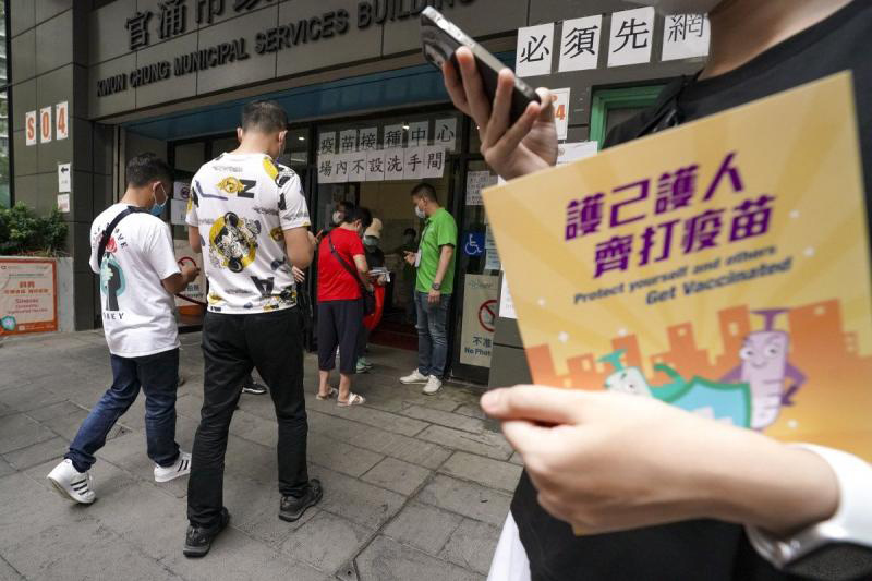 Only certain groups of people in Hong Kong must receive vaccines or face regular testing. (South China Morning Post photo)