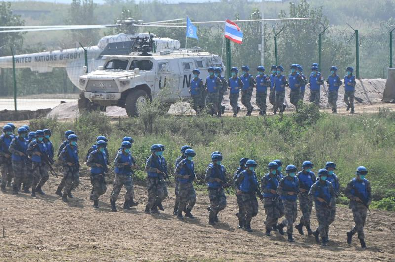 """Soldiers assemble during the multinational live exercise """"Shared Destiny-2021"""" held by the Chinese military at a tactical training base of the Chinese People's Liberation Army in Zhumadian, central China's Henan province on Wedensday. (AFP photo)"""
