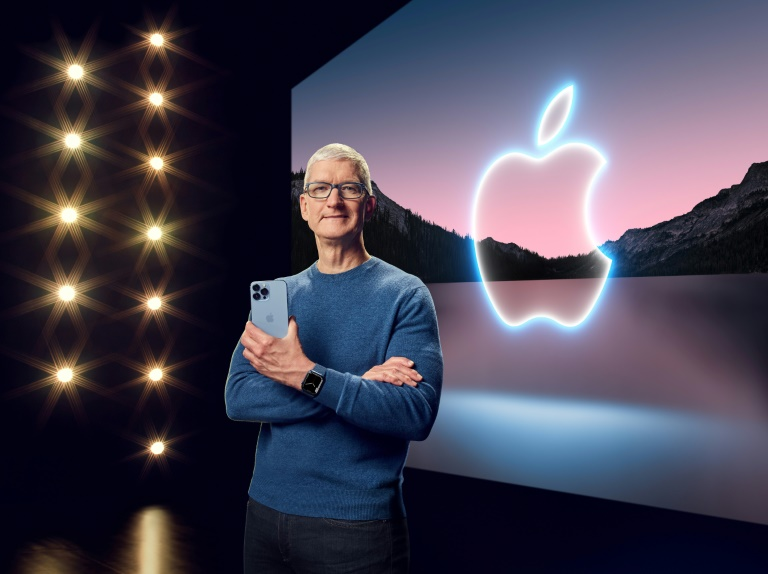 This handout image obtained Sept 14, 2021 courtesy of Apple Inc. shows Apple CEO Tim Cook with the iPhone 13 Pro Max and Apple Watch Series 7.