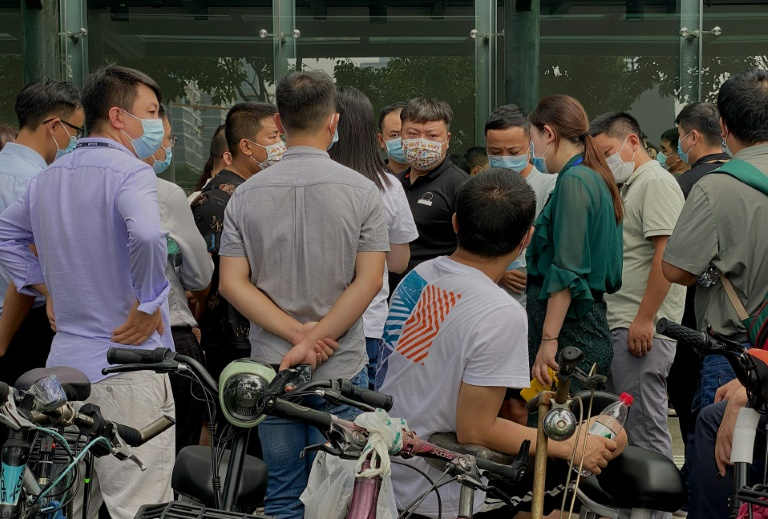 Angry investors returned to Evergrande's Shenzhen headquarters to demand their money back, and were met with a heavy police presence.