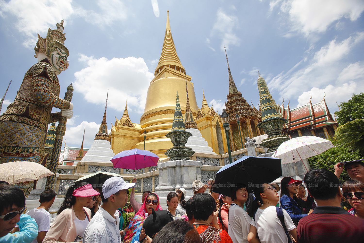 Visitors are seen at the Grand Palace. Thailand prepares to open more cities for tourists. (Bangkok Post file photo)