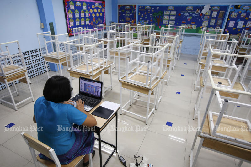 A teacher at Surao Mai School in Suan Luang district of Bangkok teaches students online in an empty classroom on June 23, 2021. (Photo: Wichan Charoenkiatpakul)