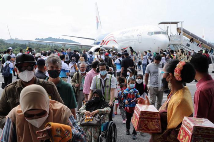 Malaysians enjoy taste of travel after tourism restarts in Langkawi