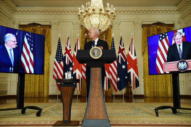 US President Joe Biden participates in a virtual press conference on national security with British Prime Minister Boris Johnson, right screen, and Australian Prime Minister Scott Morrison, left, from the East Room of the White House in Washington, DC.