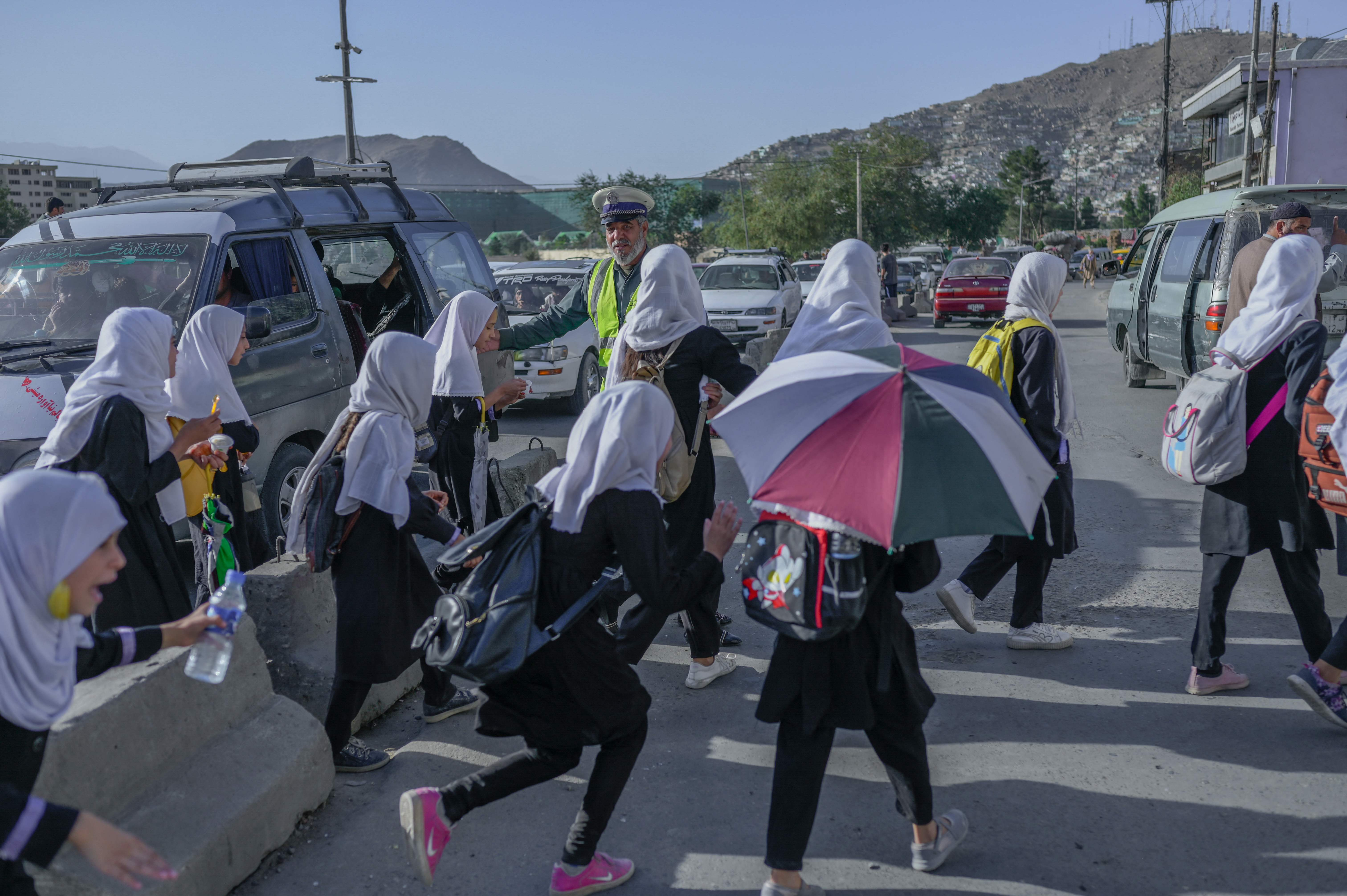 Primary school girls walk home from classes in Kabul on Monday this week. Secondary schools are now closed to girls. (AFP Photo)