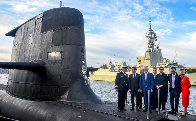 A file photo taken on May 2, 2018 shows French President Emmanuel Macron (second left) and Australian Prime Minister Malcolm Turnbull (centre) standing on the deck of HMAS Waller, a Collins-class submarine operated by the Royal Australian Navy, at Garden Island in Sydney. (AFP)
