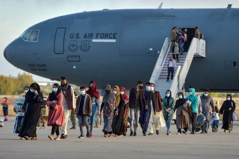 Refugees from Afghanistan disembark from a US air force aircraft at the Rota naval base in southern Spain, before heading to the United States.