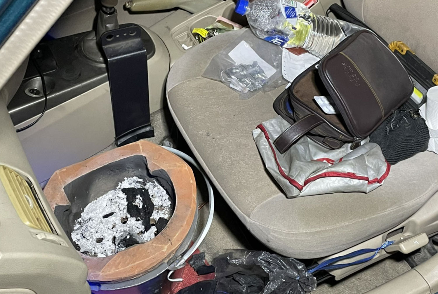 Man found dead in car with charcoal stove and ashes