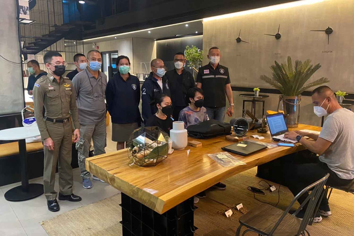 The couple arrested for streaming their sexual activities online, seated, in police custody after being arrested at a hotel in Samut Prakan province on Sept 20. (Photo: Cyber Crime Investigation Bureau)