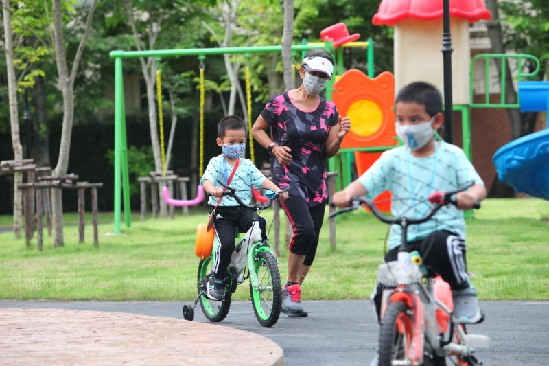 People exercise at Vibhaphirom Park after it was opened in the capital's Chatuchak district. The district office developed the park as a part of a project to promote wellness among residents. (Photo: Apichart Jinakul)