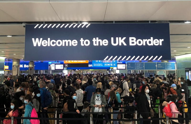 Queues of people wait in line at UK citizens arrivals at Heathrow Airport in London on Sept 1, 2021. (Reuters photo)