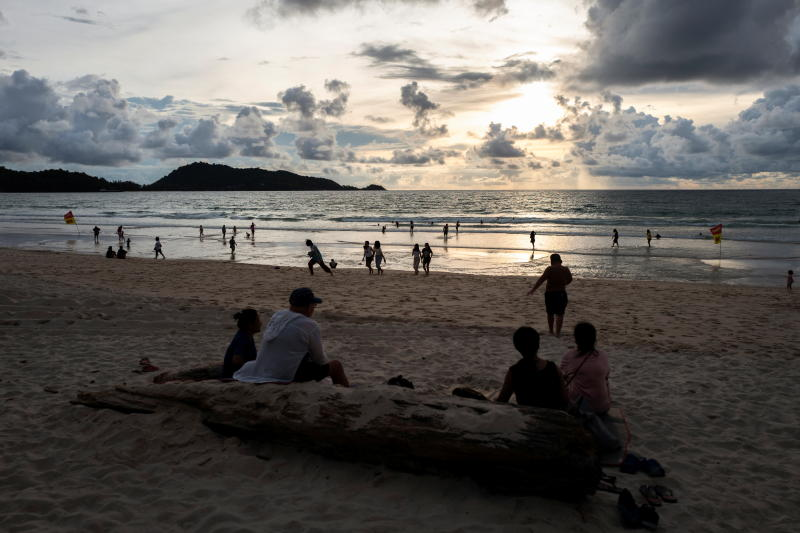 People enjoy at a beach on Sept 19, 2021, as Phuket opens for foreigners, who are fully vaccinated to visit the resort island without quarantine. (Reuters photo)