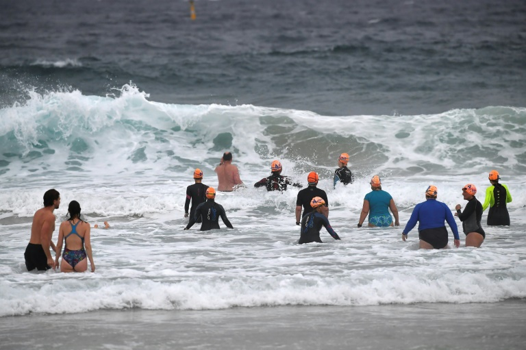 Sydney residents enjoy the waves at Bondi beach at the end of a 106-day lockdown.
