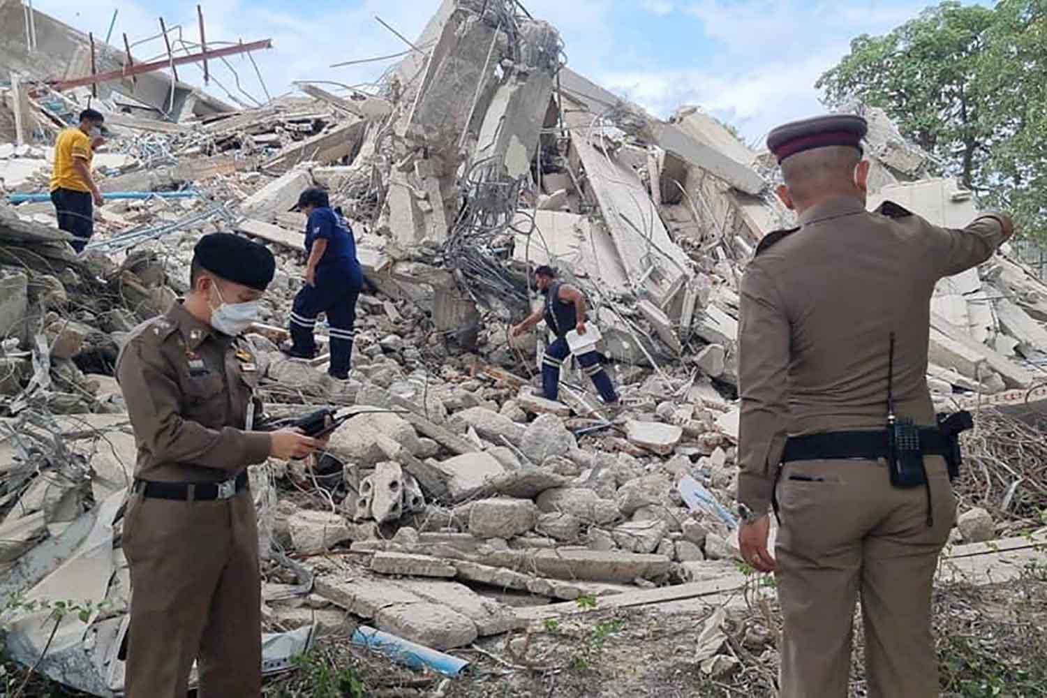 Workers injured as apartment buildings collapse