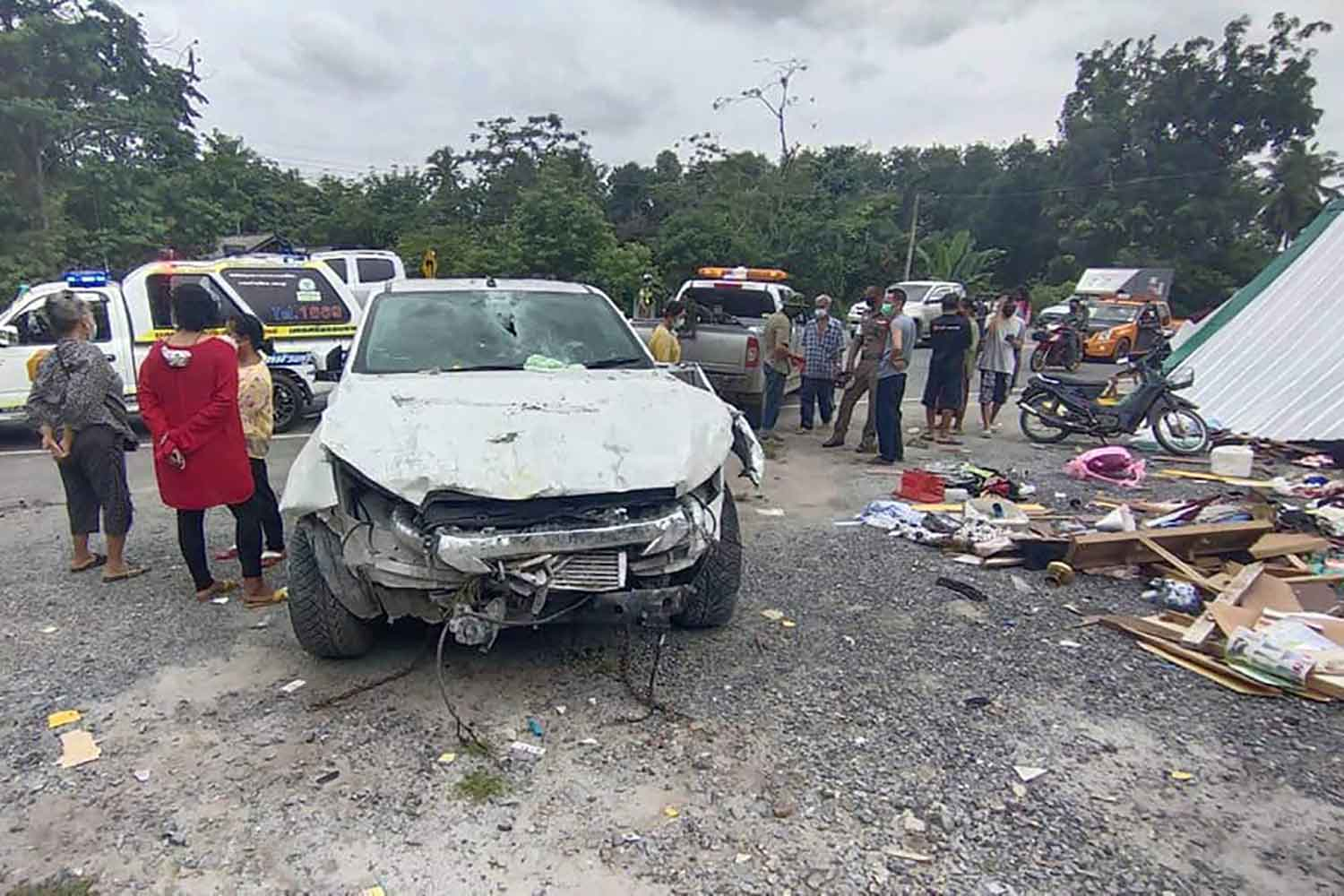 A pick-up is badly damaged after ramming into a roadside shelter and a house in Nakhon Si Thammarat's Cha-uat district on Tuesday. An elderly woman was killed. Three others, including the police driver, were injured. (Photo: Nujaree Rakrun)