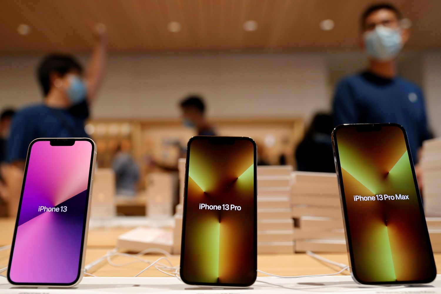 Apple's iPhone 13 models are pictured at an Apple Store on the day the new Apple iPhone 13 series goes on sale in Beijing on Septr 24. (Reuters photo)
