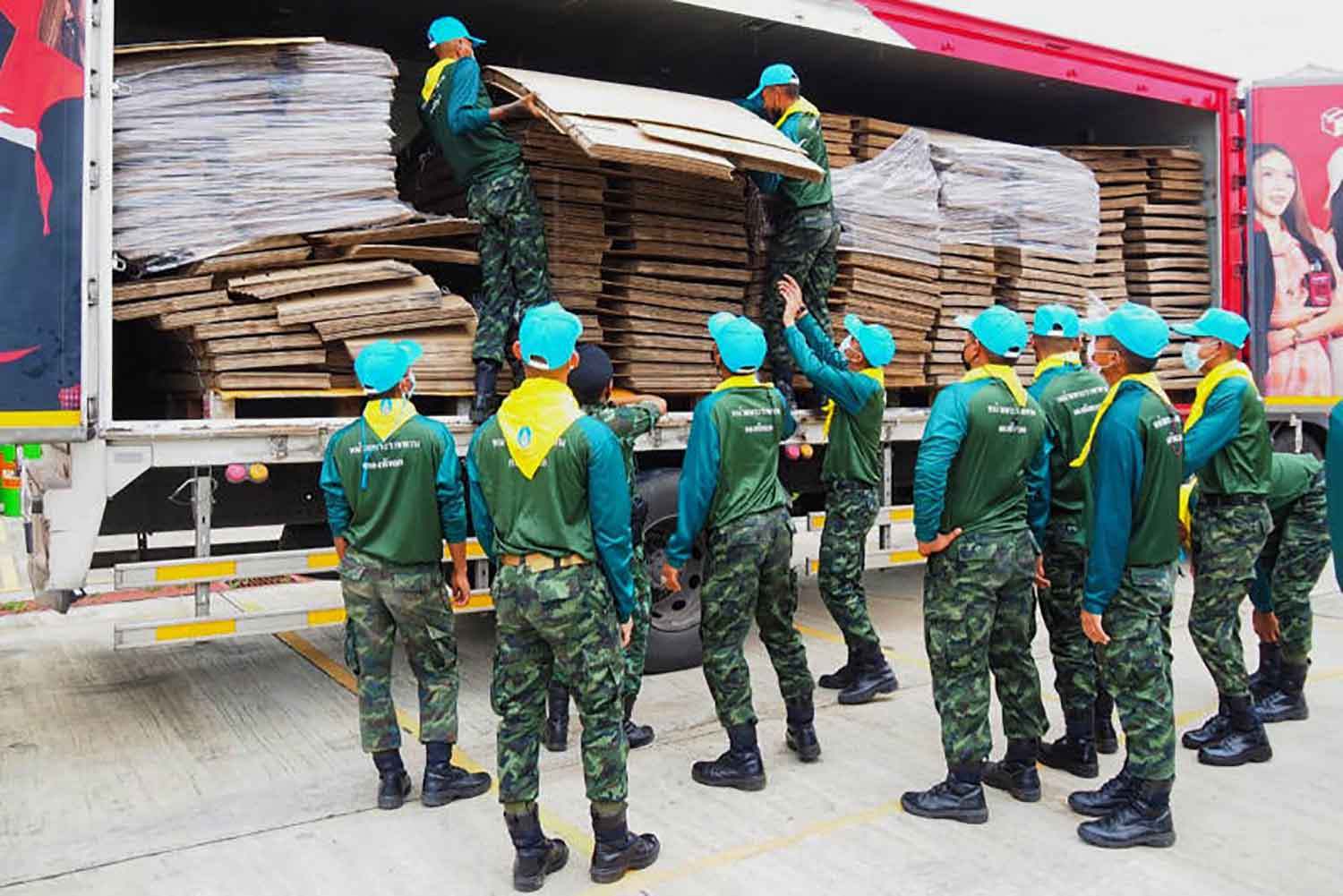Soldiers unload cardboard beds to Phokiri Ratchasuksa School that functioned as a field hospital in Khok Pho district, Pattani, in July. (Photo: Abdullah Benjakat)