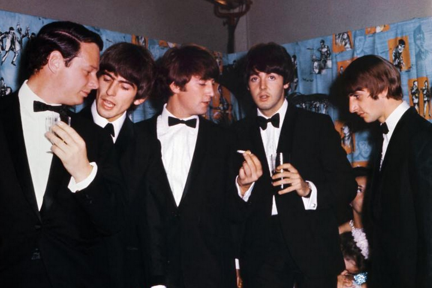 The Beatles - George Harrison, John Lennon, Paul McCartney and Ringo Starr - with manager Brian Epstein, left, at the premiere of