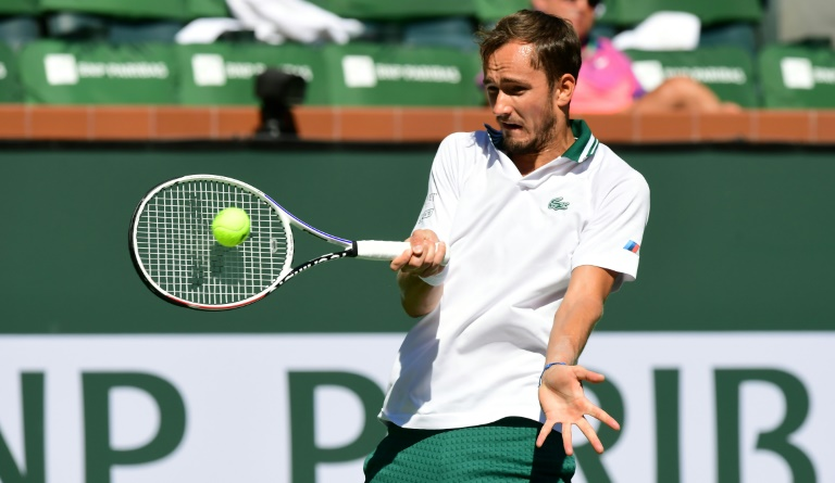 US Open champ Daniil Medvedev of Russia hits a forehand return to Grigor Dimitrov of Bulgaria in their fourth round match at the Indian Wells tennis tournament in southern California.