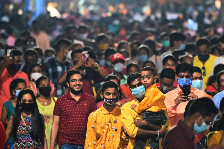 India's main religious festival season is back in full swing with huge noisy crowds thronging markets and fairs for the first time in two years.