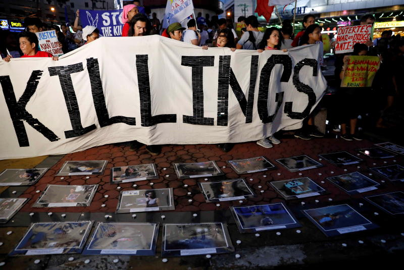 Philippines to review thousands more 'drug war' killings, says justice minister
