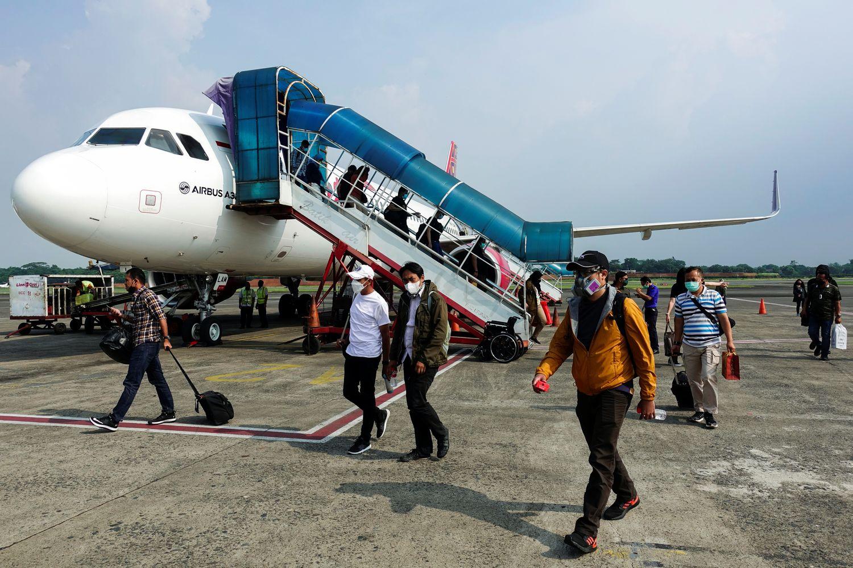 Indonesia tightens air travel curbs