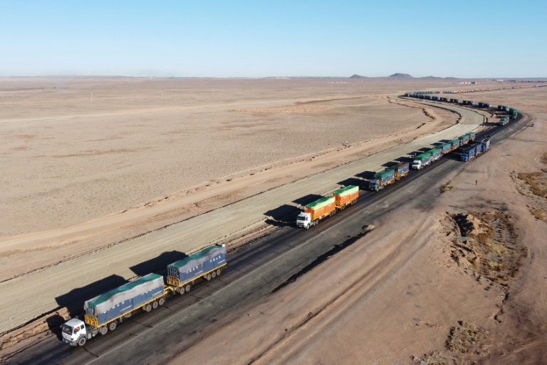 Isolated and unpaid, Mongolian coal drivers queue at Chinese border