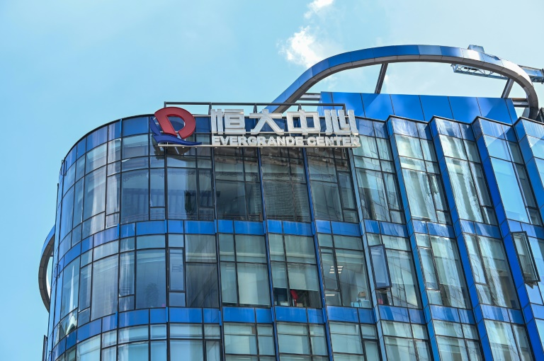 Evergrande says it has resumed work on 10 stalled projects
