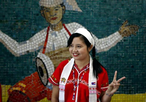 A Kayin woman poses for a photo during the opening ceremony of the Singapore-Myanmar Vocational Training Institute (CMVTI) in Yangon, Myanmar, which has embraced an attitude of 'balanced multilingualism'. (EPA photo)