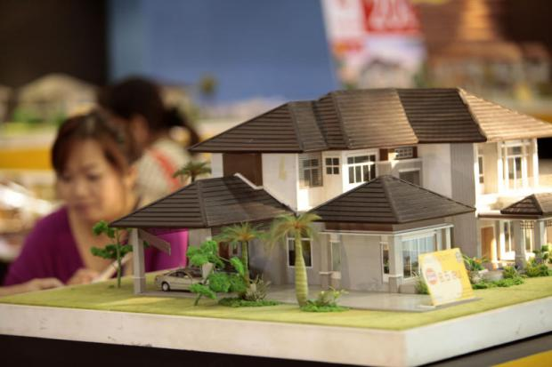 The tax is expected to have mild effects on the self-build market. APICHART JINAKUL