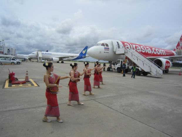 Traditional Laotian dancers welcome the arrival of Thai AirAsia's maiden flight to Vientiane on July 1. The airline hopes to capitalise on growing tourism demand in the country. BOONSONG KOSITCHOTETHANA