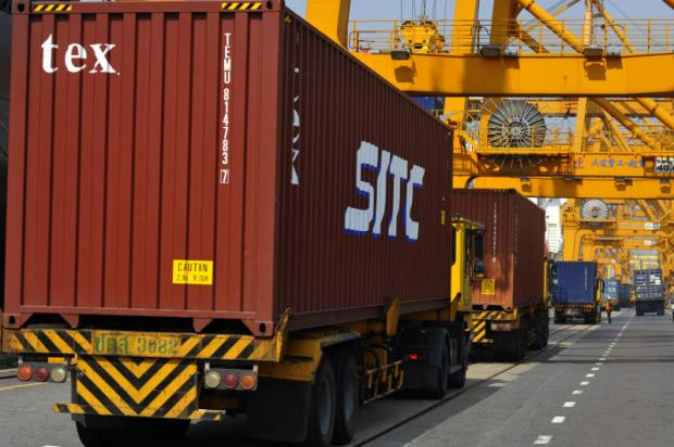 Trucks with containers head to Bangkok Port. A range of issues may lead to a longer than expected recovery for exports.WICHAN CHAROENKIARTPAKUN