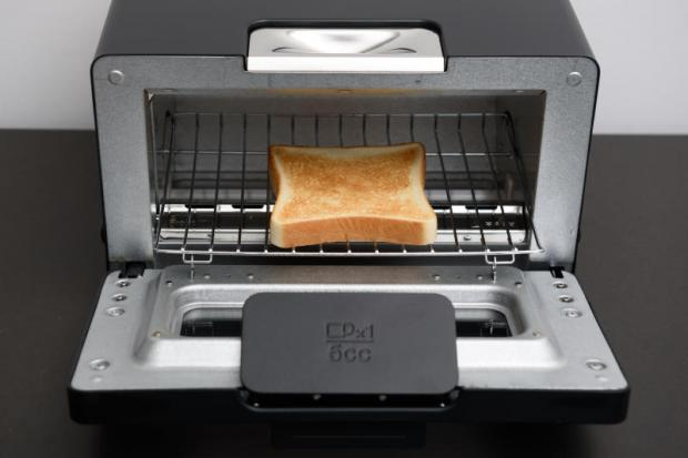 A slice of bread is toasted with a Balmuda toaster during a demonstration in Tokyo on May 19, 2016.(Bloomberg Photo)