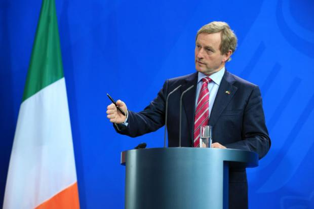 Enda Kenny, Ireland's prime minister, talks in Berlin, Germany, last Tuesday. Mr Kenny said Chancellor Angela Merkel is 'clearly aware of our situation', referring to the border with Northern Ireland and its post-Brexit relationship with EU.(Bloomberg photo)