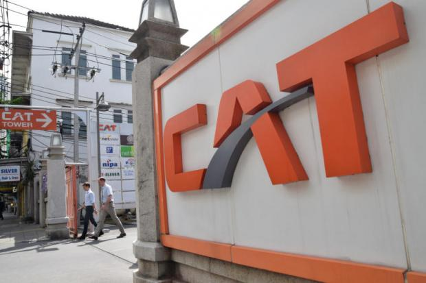 People walk out of CAT Tower in Bangkok's Bang Rak district. CAT and another state-run telecom operator, TOT, have been on survival plans that forced them to cut unprofitable businesses. PANUMAS SANGUANWONG