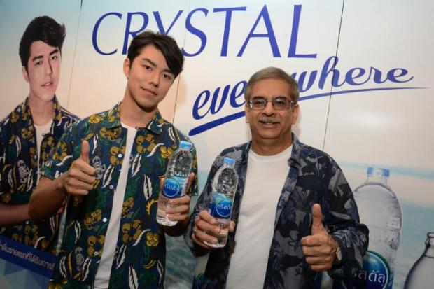 Mr Chhabra (right) with Crystal presenter Naphat 'Nai' Siangsomboon.