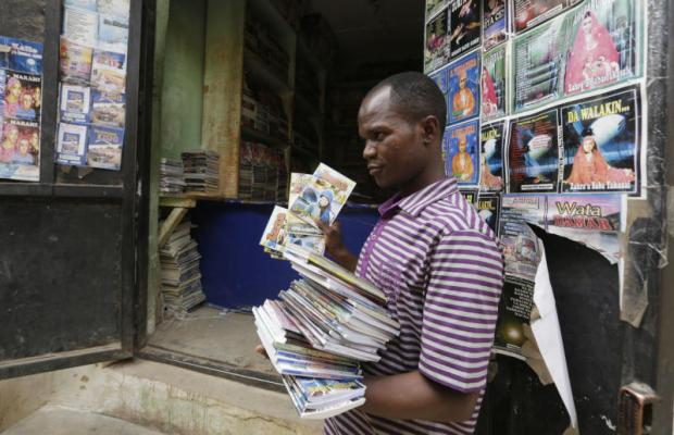 Book hawker Adamu Saidu displays novellas he purchased at Kurmi Market to be sold in villages inaccessible by car in Kano, Nigeria. (AP file photo)